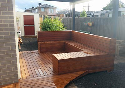 A stunning pergola and inbuilt timber seat and timber deck.