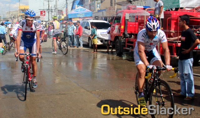 Firetrucks shower the riders of Le Tour de Filipinas 2013