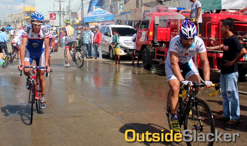 Firetrucks shower the riders of Le Tour de Filipinas 2013
