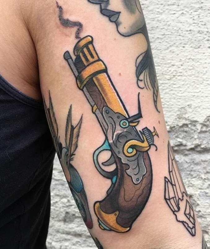 Traditional Gun Arm Tattoo