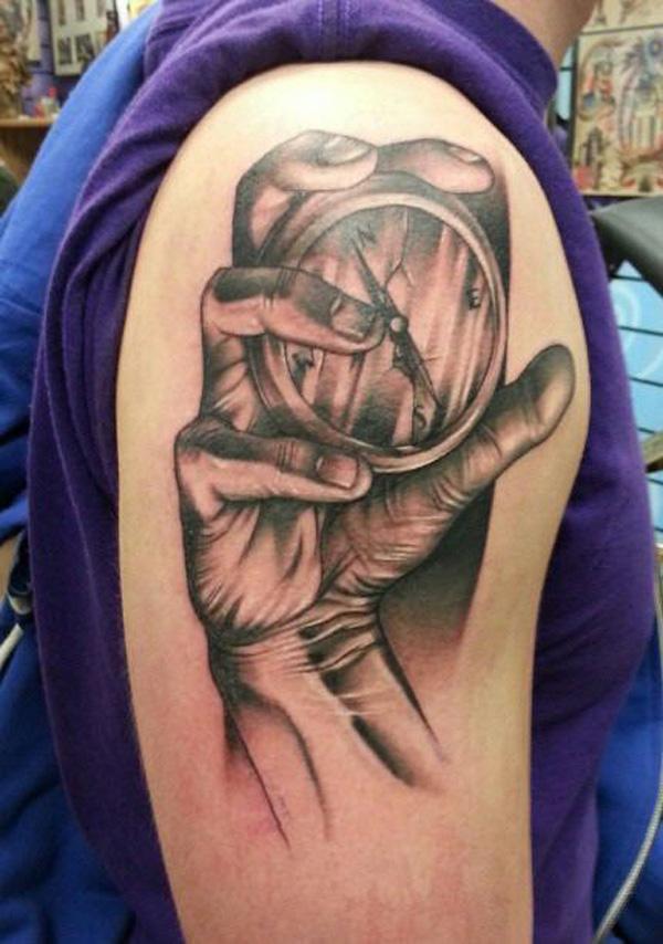 hand compass tattoo