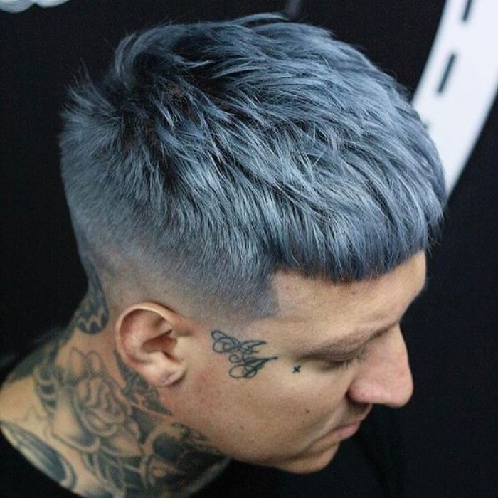 Man with tattoos and Grey hair with skin fade