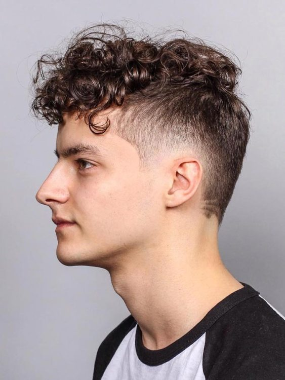 male with curly top drop fade