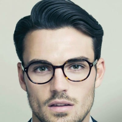 Man with side part and black glasses