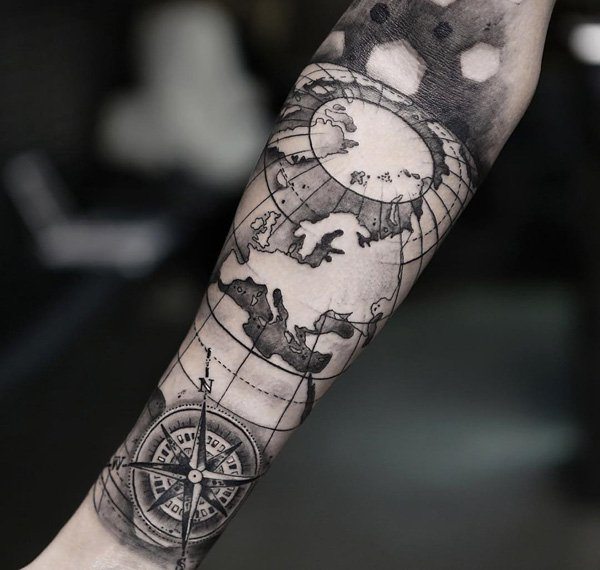 compass and map forearm tattoo