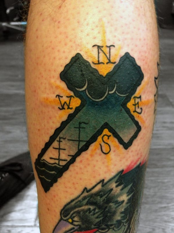 Inner Arm Cross Tattoo
