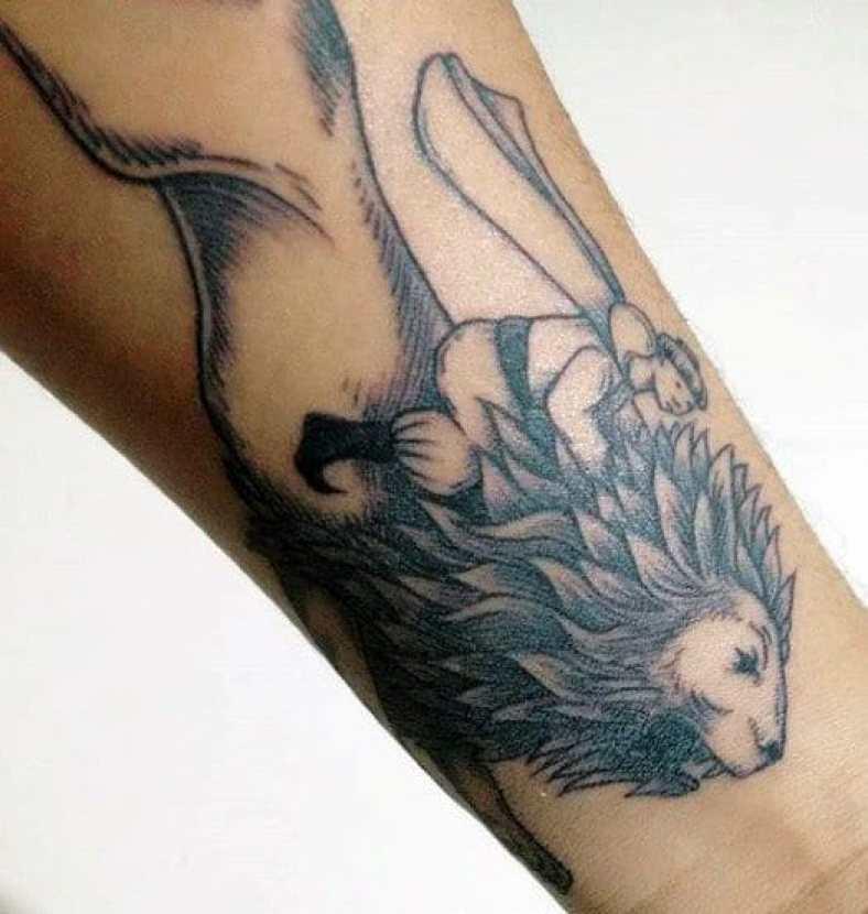 Man on a Lion Tattoo