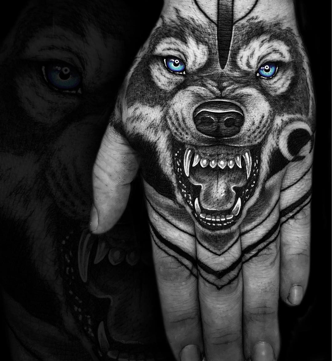 Blue Eyed Wolf Hand Tattoo