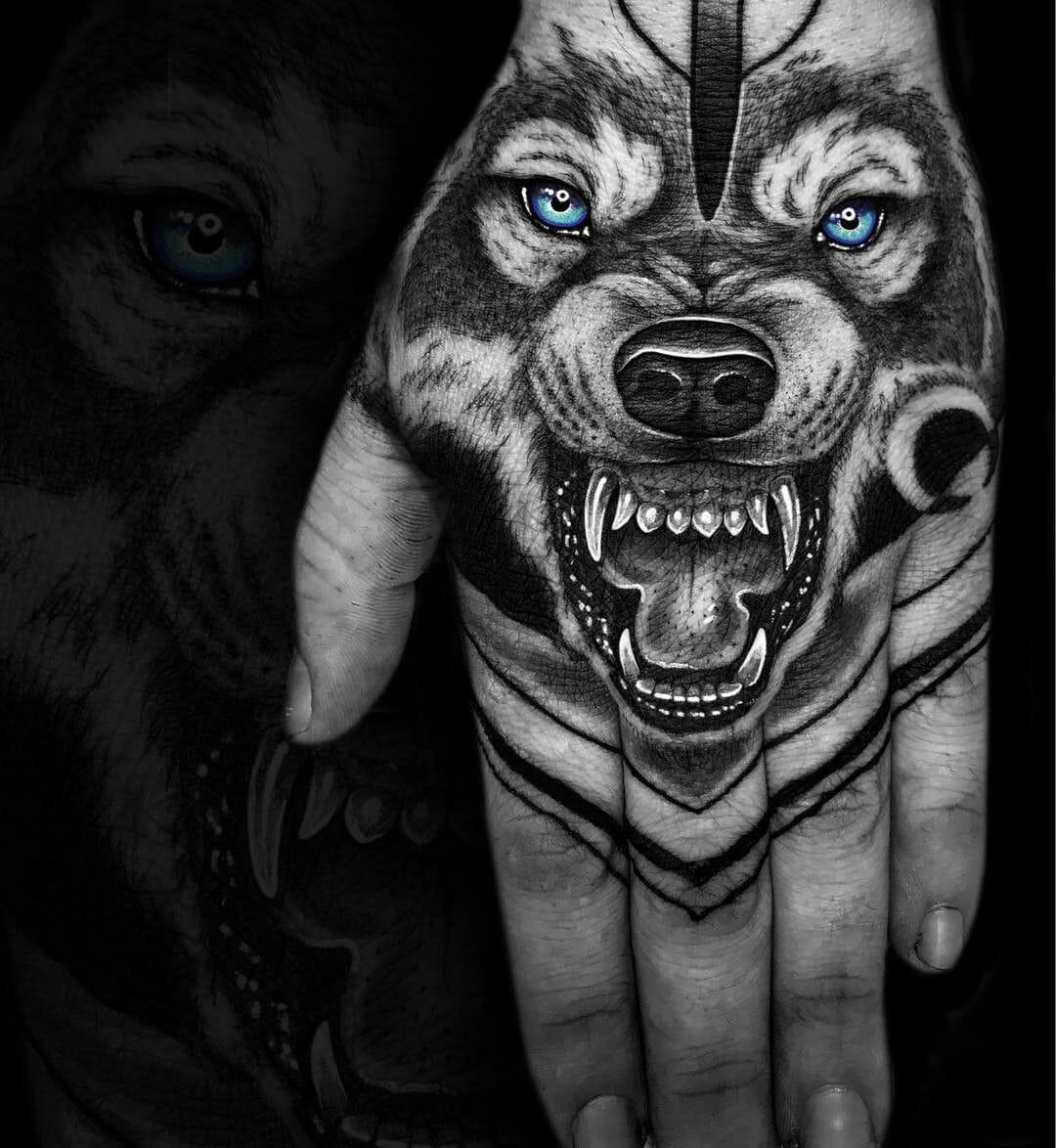 Blue Eyed Wolf Hand Tattoo