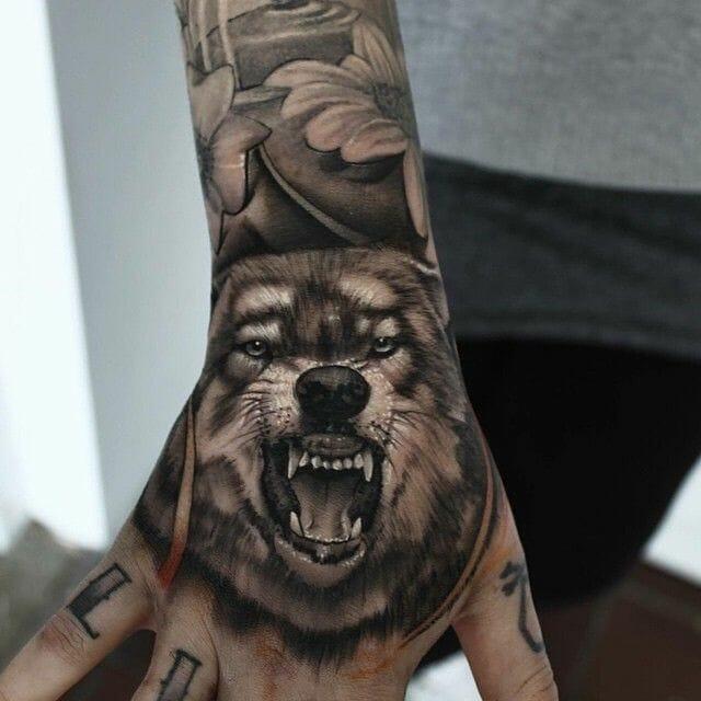 Roaring Wolf Hand Tattoo