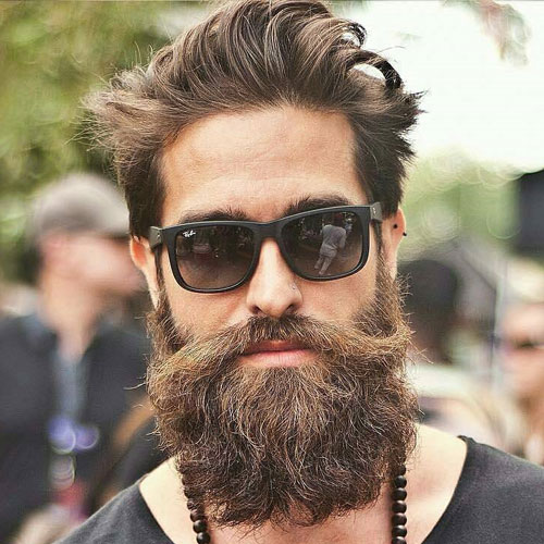 Textured Loose Hairstyle with The Verdi Full Beard