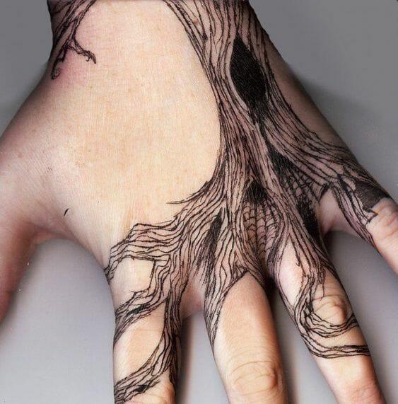 Tree Roots Hand Tattoo