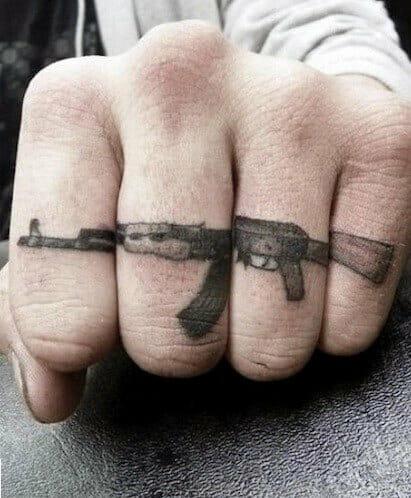 Gun Hand Tattoo