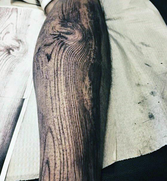 wood grain leg tattoo