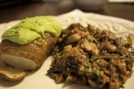 Final mushroom dish with a hasselbacked potato and homemade spinich pesto