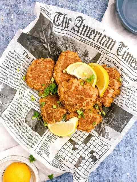 tuna patties on a newspaper