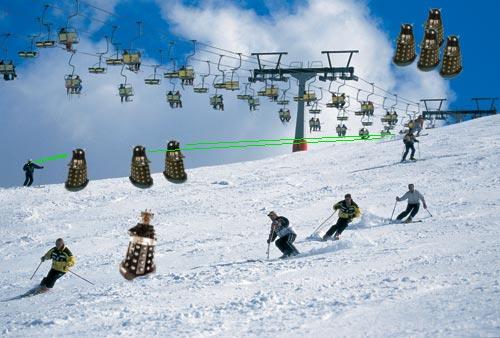 a delightfully dodgy photoshop job of Davros and Dalek minions on the ski slopes