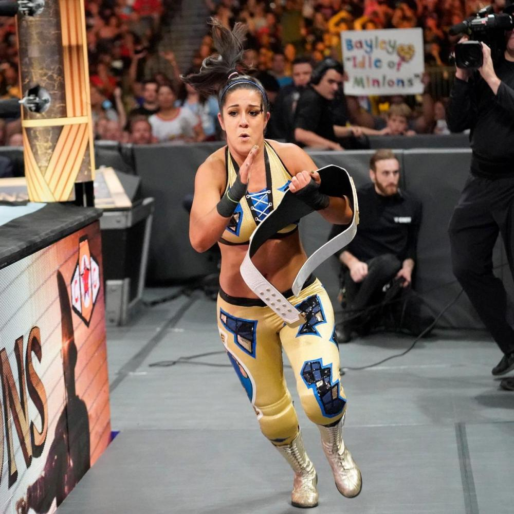 Bayley sprints to the locker room in fear Clash of Champions