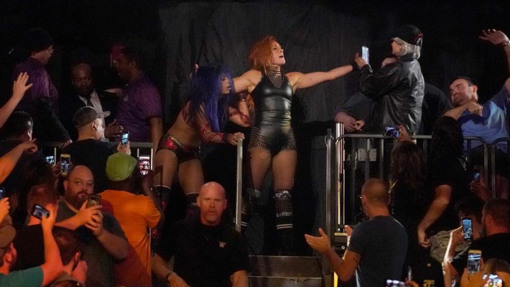 Becky Lynch giving The Boss a Lass kicking in the stands Clash of Champions