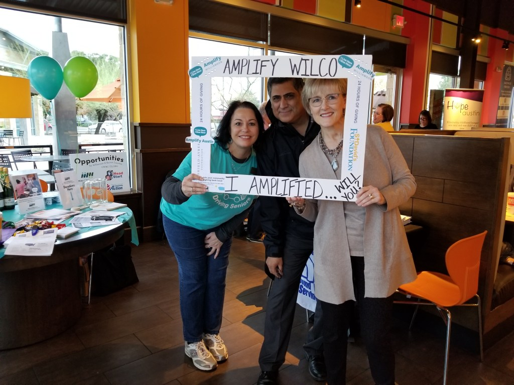 Executive Director, Marco Cruz, Commissioner Covey, and nonprofit member at Amplify Kickoff