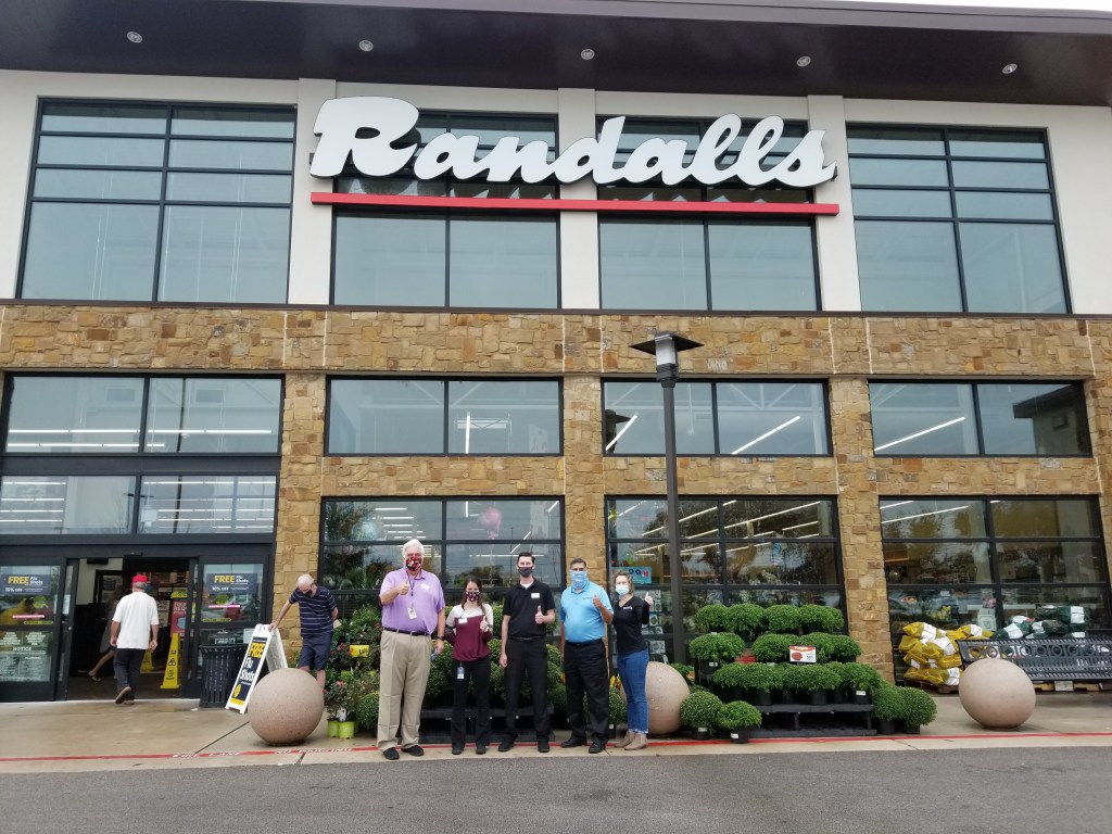 Randalls staff pose for a group photo outside of the Williams Drive store with OWBC's E.D.