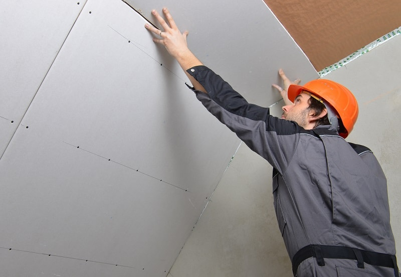 a drywall and ceiling tile installer