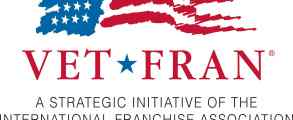 """A stylized American flag logo appears over the text """"VetFran. A strategic initiative of the International Franchise Association since 1991."""""""