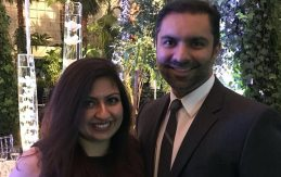 Pearle Vision Licensed Owners Amir and Ambreen Essani pose for a photo at a banquet.