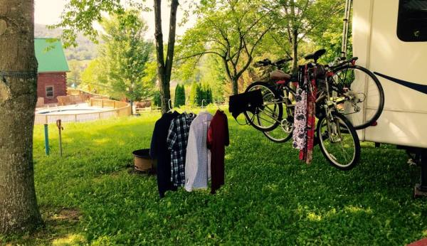 This is not a clothesline. Clotheslines make RV parks look tacky. This is a Canine Tie-Out Drying Apparatus with Optional Handlebar Lingerie Hanging Accessory. I win.
