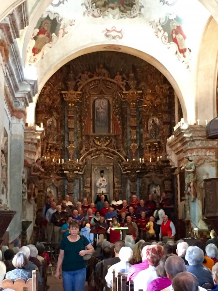 Inside Mission San Xavier, the choir was rehearsing for a Christmas concert.