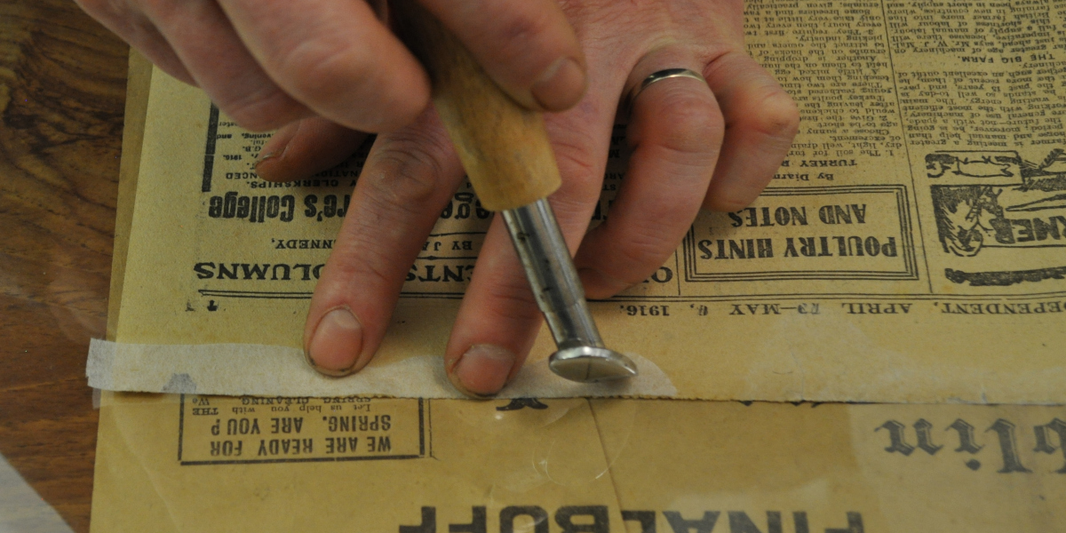 Heat set tissue repair on 1916 newspaper