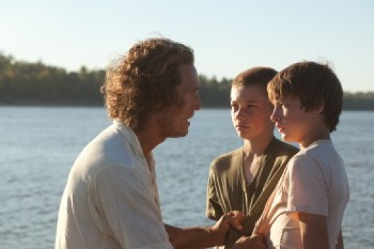 Michael McConaughey, Jacob Lofland and Tye Sheridan surrounded by water
