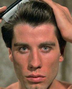 John Travolta. Aquarius Sun.