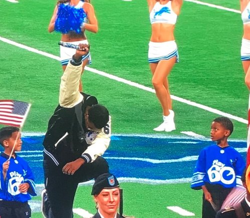 In Detroit today, the artist singing the national anthem ended on bended knee.