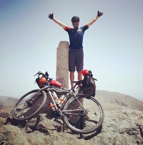 Mark Osborne on top of the 3300m Pico del Veleta in Spain's Sierra Nevada, the highest paved road in Europe.