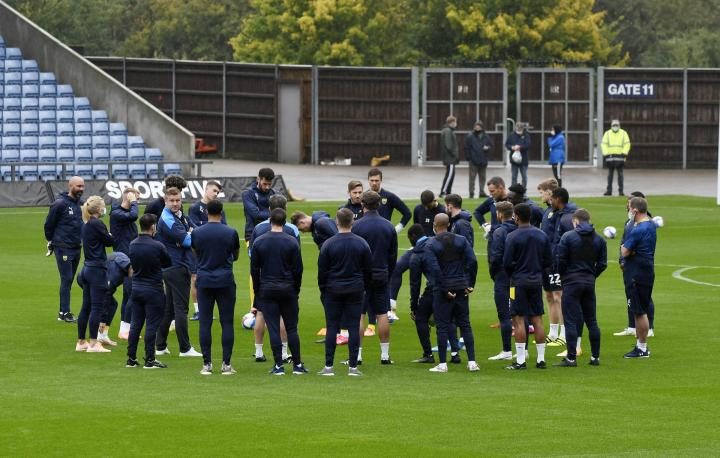 Oxford United players and staff at the Kassam Stadium on Saturday Picture: David Fleming