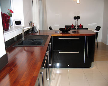 Kitchens Case Study Ultra Modern Gloss Iroko And Brushed Steel