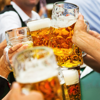 Prost! Oktoberfest attendees cheers in Munich. Credit: Nikada/iStockPhoto