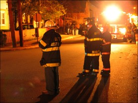 Oyster Bay Engine 558 securing a hydrant on Orchard Street.