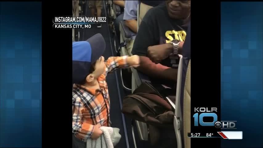 KC Boy Offers Fist Bumps to Flight Passengers_34450171