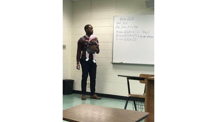PROFESSOR HOLDING BABY_1552227822504.jpg.jpg