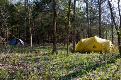 Two tents at a wild campsite in Piney Creek Wilderness on the shores of Table Rock Lake.