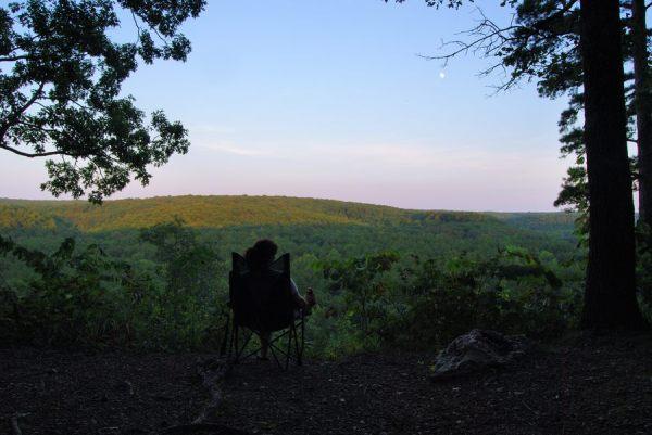 Ginger Davis Allman enjoying the evening view at Pines Overlook Campsite