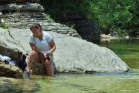 Ginger filtering water at Long Creek falls