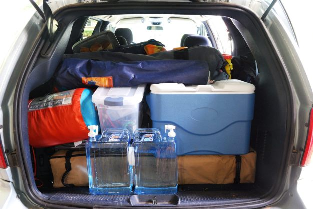 Chrysler Town and Country Minivan packed full of car camping gear