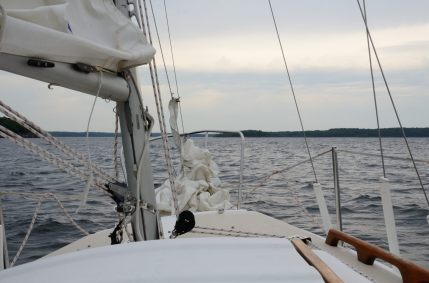 View looking forward from the cockpit of the sail boat Cornucopia on a cloudy day on Stockton lake