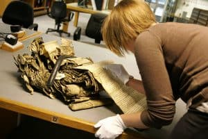 800px-A_researcher_working_with_delicate_resource_at_The_National_Archives