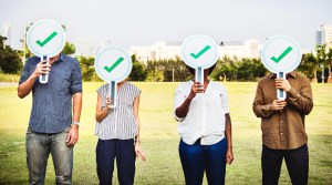 Job candidates covering face with positive masks