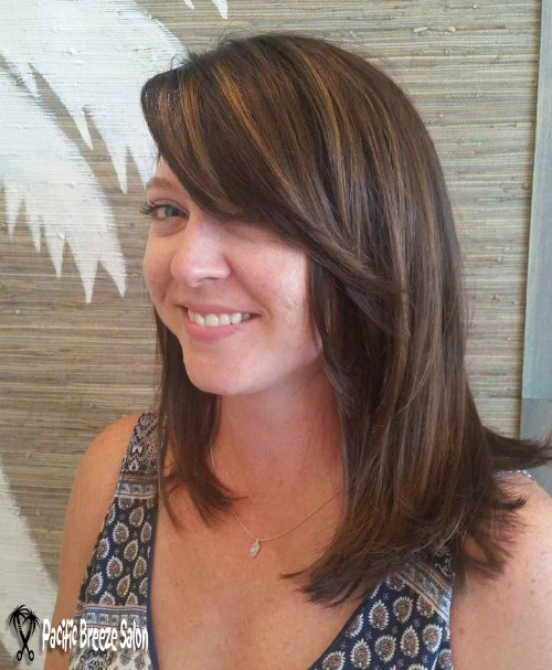 "Stylist Mary Dennis added all over color in a rich, warm brown. Highlights & lowlights were added for dimension, and lots of layers and bangs were added for texture & shape. Ask for a ""pinwheel"" pattern like this for a soft, natural flow of color."