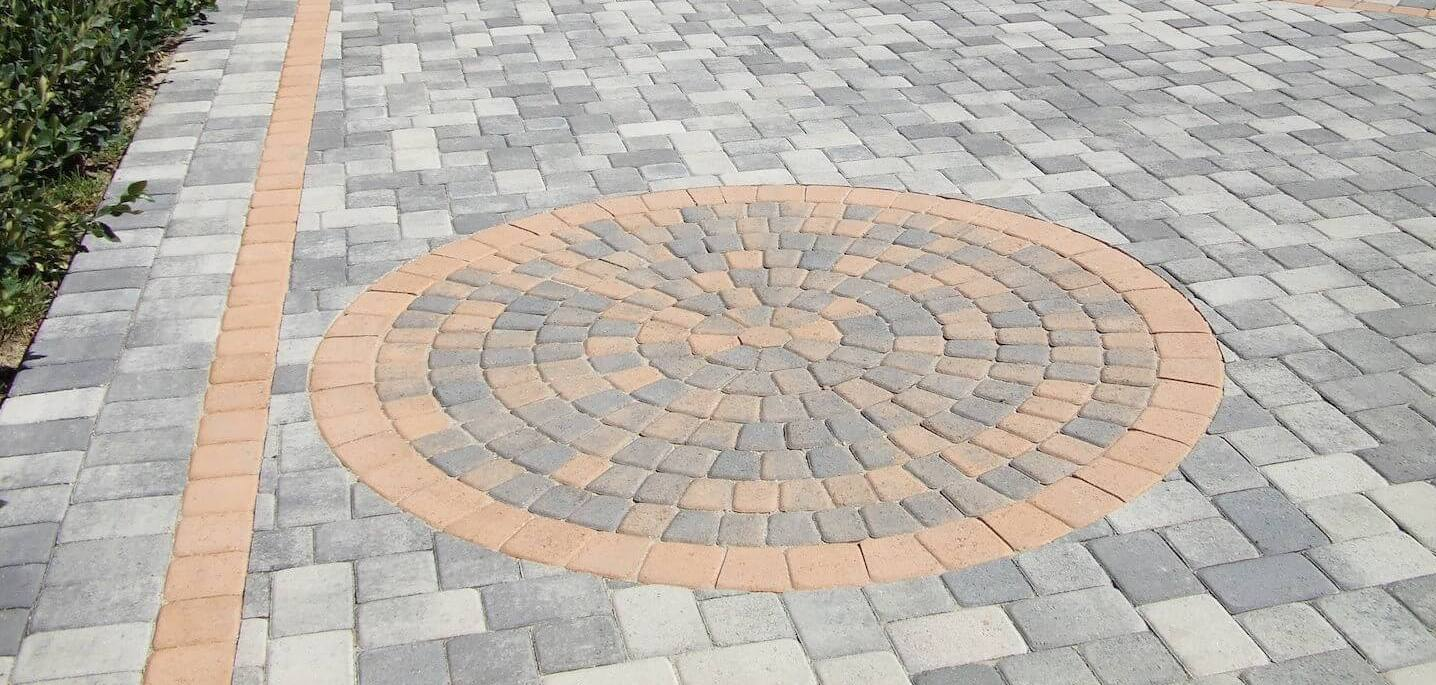 how to install pavers over concrete